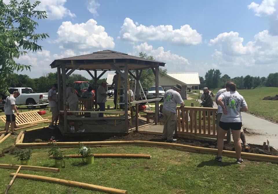Volunteers building a gazebo